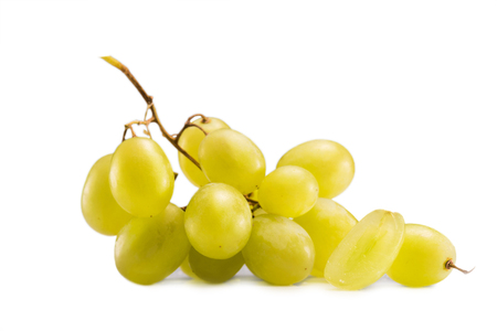 close up view of cluster of fresh grapes isolated on white