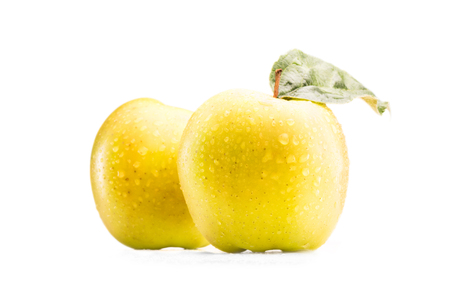 close up view of fresh and ripe apples with water drops isolated on white