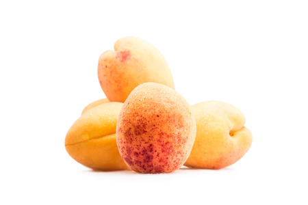 close up view of fresh sweet apricots isolated on white