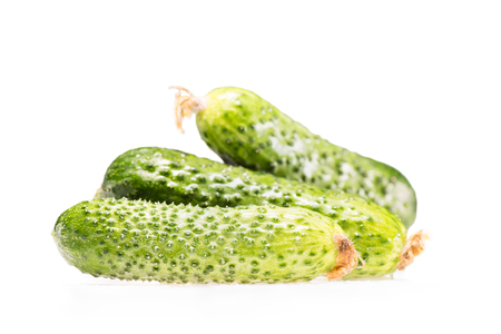 pile of three ripe fresh cucumbers isolated on white 스톡 콘텐츠