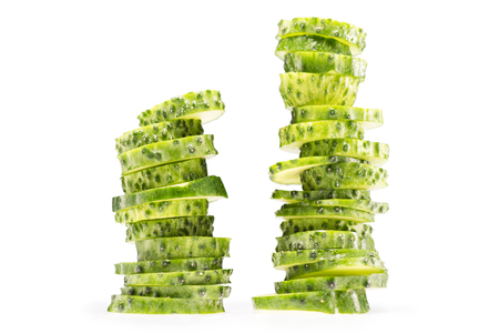 two stacks of sliced fresh cucumbers isolated on white