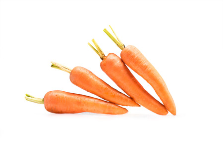 pile of fresh ripe healthy carrots isolated on white