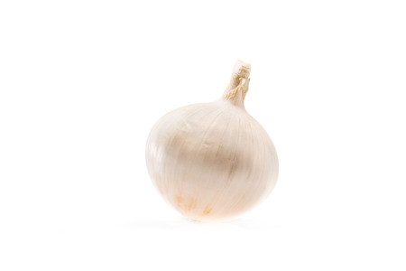 healthy ripe white unpeeled onion isolated on white