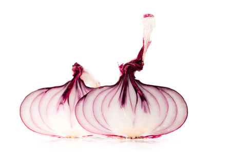 halves of fresh ripe red onion isolated on white