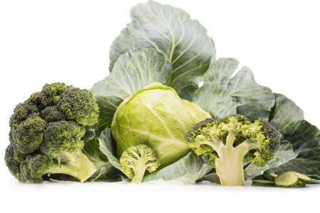 still-life of healthy fresh cabbage and broccoli isolated on white