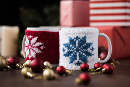 selective focus of ceramic cups and shiny christmas balls