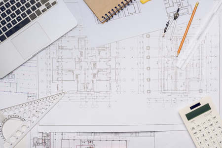 flat lay with blueprints and arranged architecture equipment