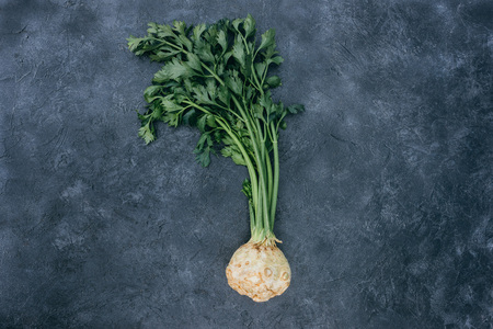 top view of healthy celery with root on black