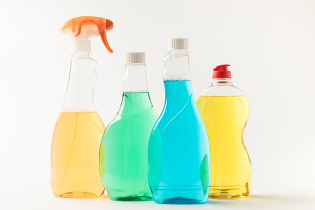 close-up view of plastic bottles with colorful cleaning fluids isolated on white  Stock Photo