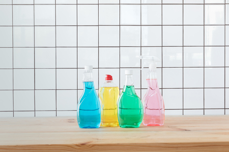 close-up view of plastic bottles with colorful cleaning fluids on tabletop