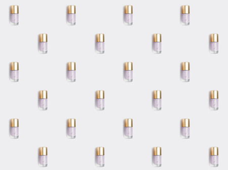 repetitive pattern of nail polish bottles 写真素材