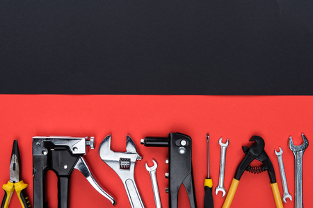 Top view shot of different reparement tools - wrenches, pliers, industrial stapler