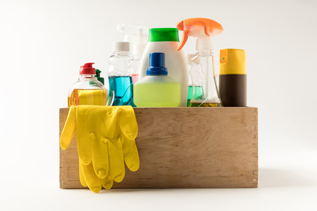 close-up view of various cleaning equipment in box isolated on white