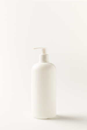 close-up view of white plastic bottle of cleaning product isolated on white