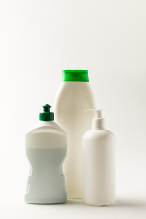 close-up view of various plastic bottles of cleaning products isolated on white Reklamní fotografie