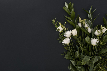 top view of bouquet with eustoma flowers over black background 스톡 콘텐츠