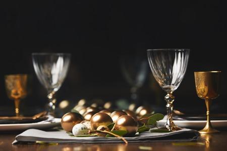 easter golden eggs on wooden table in restaurant