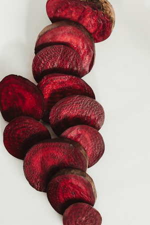 top view of red sliced beetroot on grey Stock Photo