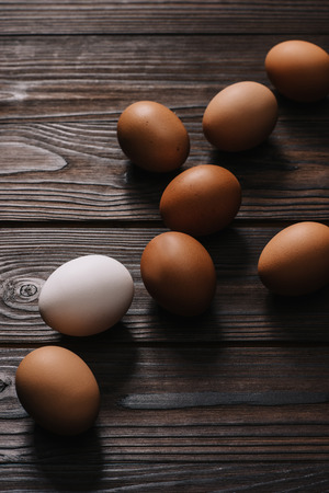 chiken eggs on wooden brown table