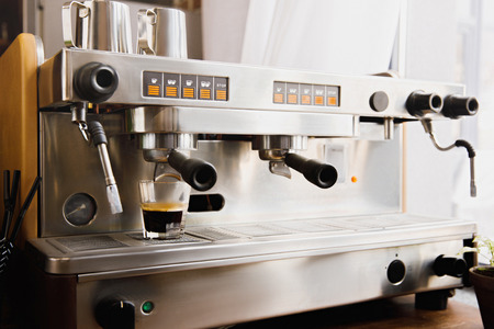 Cooking coffee on modern espresso machine