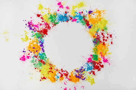 circle frame of multicolored traditional powder, isolated on white, festival of colours Stock Photo