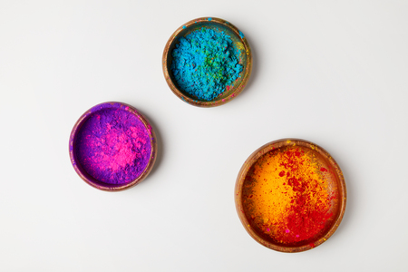 top view of colorful holi powder in three bowls isolated on white, Hindu spring festival