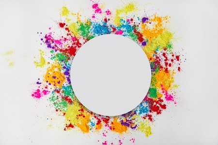 circle frame of colorful traditional powder, isolated on white, traditional Indian festival of colours Stock Photo