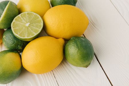Raw citruses on white background