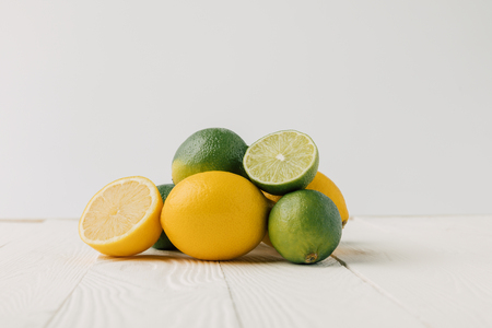 Lemons and limes on white background