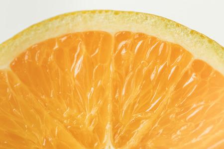 Close-up view of ripe orange fruit flesh