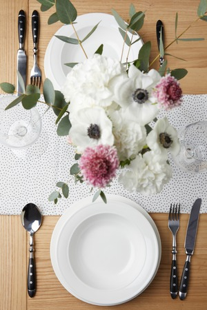 Festive table with cutlery and plates