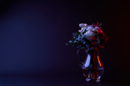 bouquet of different flowers in carafe with water Banco de Imagens