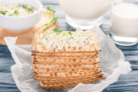close-up view of crackers with topping of cottage cheese on wooden table