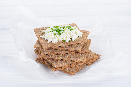 close-up view of tasty crispy crackers with cottage cheese
