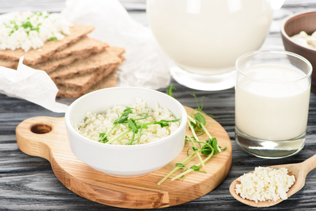 close-up view of delicious healthy cottage cheese and milk on wooden table