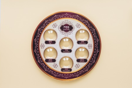 top view of traditional jewish plate isolated on beige, Passover Haggadah concept