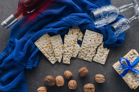 top view of matza, wine and walnuts on table, jewish Passover holiday concept Stock Photo