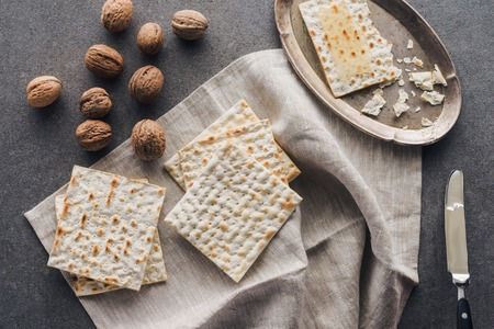 top view of matza and walnuts on concrete table, jewish Passover holiday concept Stock Photo