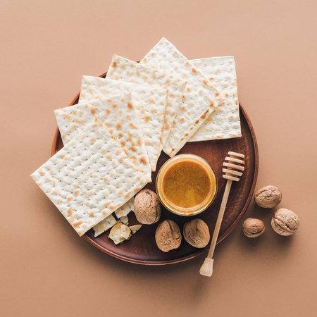 top view of matza with honey on tray, Passover Haggadah concept