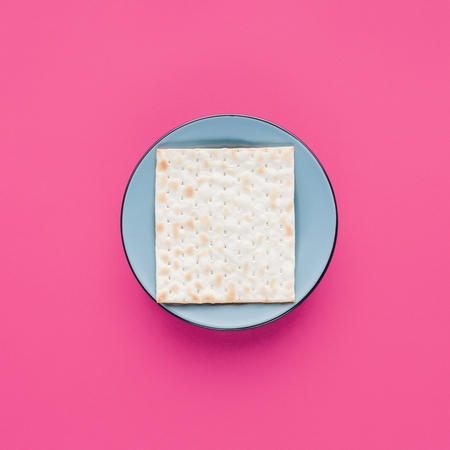 top view of plate with matza isolated on pink, Passover Tale concept