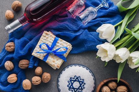 top view of kippah, matza and wine, jewish Passover holiday concept Stock Photo