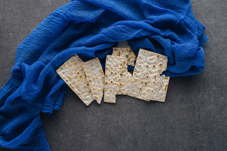 top view of matza on blue tablecloth, Pesah celebration concept Stock Photo