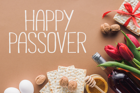 top view of happy passover greeting and matza on brown, Passover Tale concept Standard-Bild