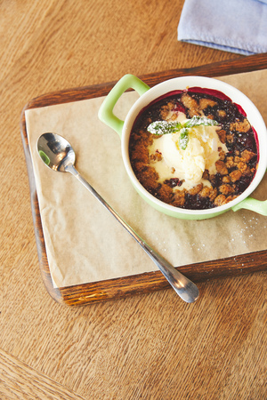 Berry cobbler with mint and ice cream
