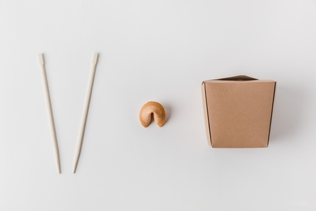 top view of noodles box with chopsticks and chinese fortune cookie Stock Photo - 99972833