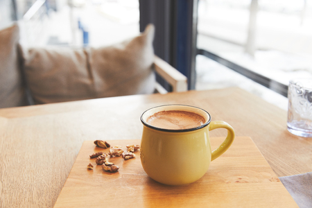 Mug with hot cocoa served with nuts Stockfoto