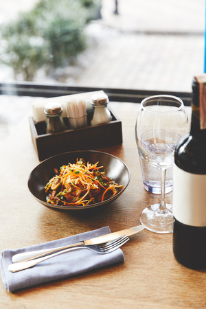 Udon noodles with pork served on table with wine 版權商用圖片