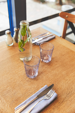 Table setting with glasses and mint water