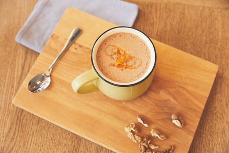 Hot chocolate drink with orange peel serve in cafe