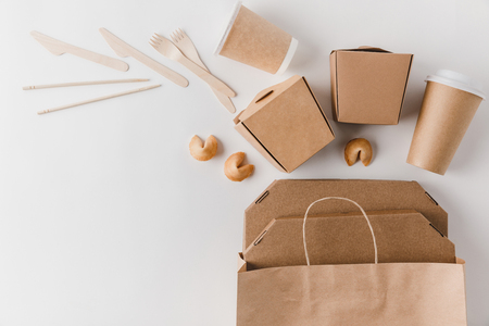 top view of junk food in take away boxes and chinese fortune cookies on white